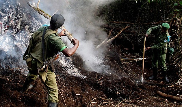 Threat of Deforestation ~ Rangers Destroying a Charcoal Kiln in Virunga National Park.